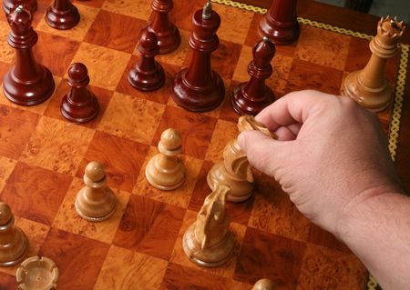 checkmate: A rather neat checkmate with a knight, by someone who knows how to make the right move. Stock Photo