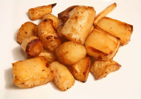 parsnips: Parsnips roasted golden-brown in the oven Stock Photo