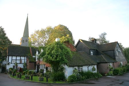 english village: An ancient English village - Horley - in Surrey, soon after dawn, with the parish church and the village pub.