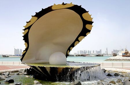 The oyster and pearl fountain, beside the old Dhow Harbour on Doha Corniche, Qatar, Arabia