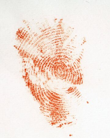 The print of a bloodied finger on a piece of white tissue - perhaps a crime scene clue?  Print is authentically imperfect. Texture of tissue is visible (but could easily be blown out if desired) Stock Photo - 832341
