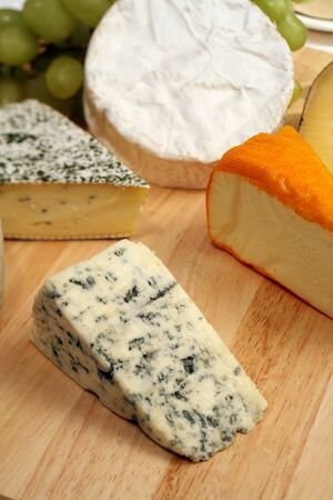 A cheeseboard, Danish blue to the front, with a selection of gourmet cheeses photo