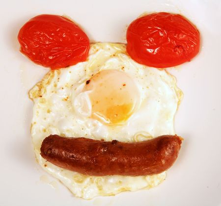 breakfast smiley face: A smiley face of tomato, egg and sausage