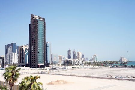 A view of the Doha skyline in October, 2006, showing the high-rise New District, which is still under construction. The building in the foreground suffered a fire.