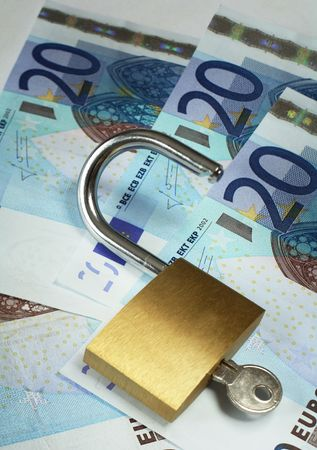 gaining: An opened padlock on a background of 20 euro banknotes. Symbolic of gaining access to wealth.