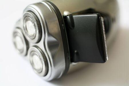 electric razor: The trimmer on a portable electric razor, macro. Stock Photo