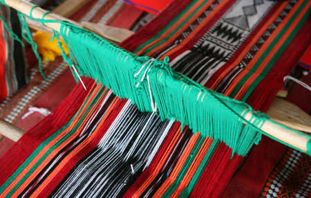 loom: A loom producing the traditional Arab cloth design, commonly used in Qatar and other Arab states.