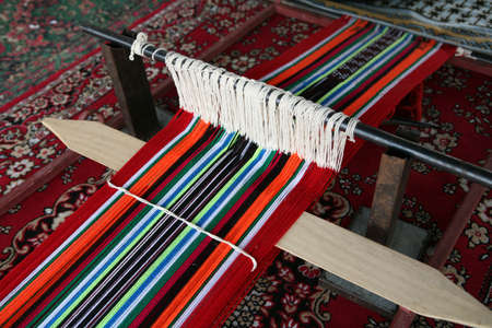 weft: A traditional, simple, Arab loom set up to produce the sort of cloth that is common throughout the Arab world.