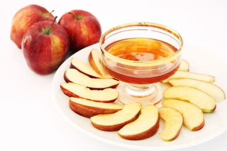 Red delicious variety of apple with a bowl of honey, symbolic of the Jewish New Year. photo