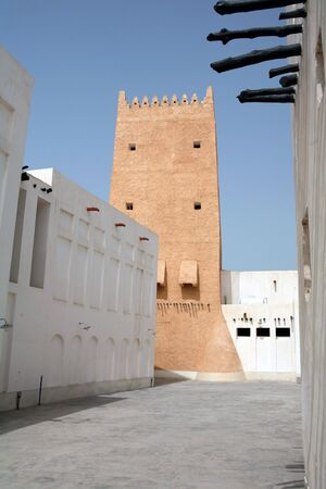suq: A tower and other buildings in the old souq, Doha, Qatar