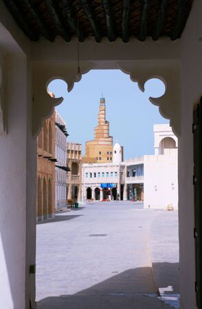 propagation: View of Doha, Qatars rebuilt Old Souq area, looking towards the spiral mosque of the Qatar Centre for the Propagation of Islam