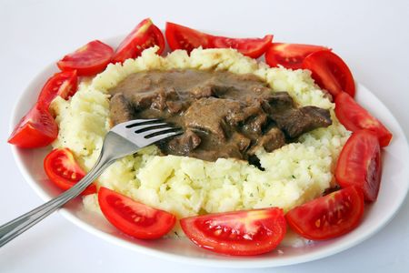 creamed: Beef stroganoff served on a bed of creamed parsley potato, ringed by wedges of small organic tomatoes.