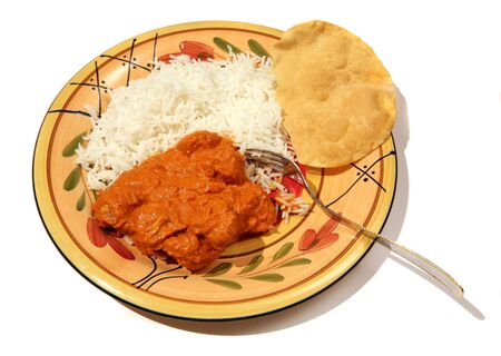 A butter chicken curry with Basmati rice and a poppadom. photo