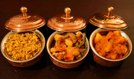 From left, coconut pilau rice, vegetable curry and punjabi potato curry, ready for the plate.