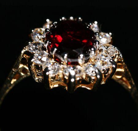 zircon: A gold, diamond and ruby ring, symbol of romance.