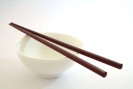 starvation: Chopsticks lying on an empty rice bowl. Stock Photo
