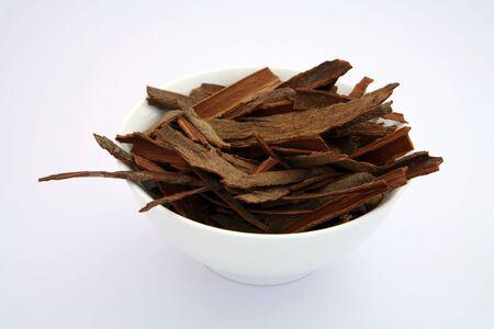 cassia: Indian Cinnamon sticks (cassia bark) in a white bowl.