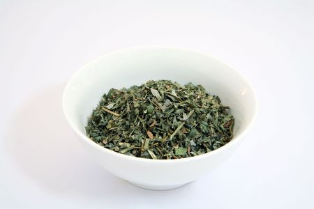 fenugreek: A bowl of methi - dried fenugreek leaves - used as a flavouring in Indian curries and stews.