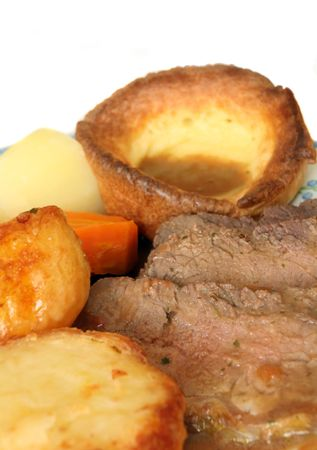 Roast beef and Yorkshire pudding, roast and boiled potatoes, boiled carrots and gravy. A traditional British Sunday dinner photo