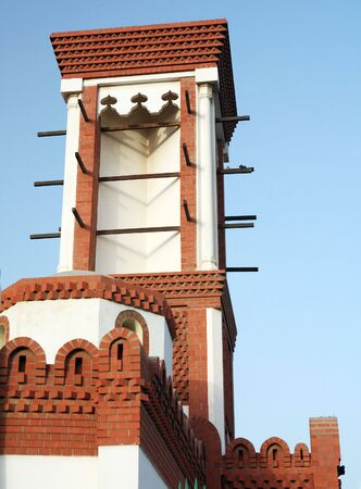 windtower: A traditional-style wind-tower - a simple form of air conditioning - on a building on the Corniche in Doha, Qatar