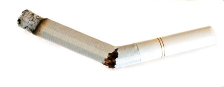 breaking free: A lit, broken cigarette, symbolising breaking free of the addiction. Stock Photo