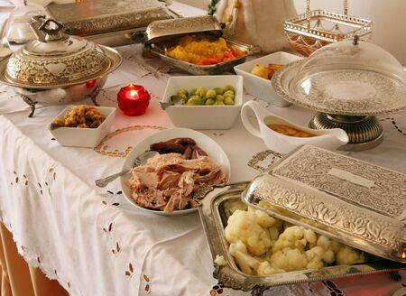 a christmas buffet table with silverware containing all the traditional english christmas dinner delicacies stock