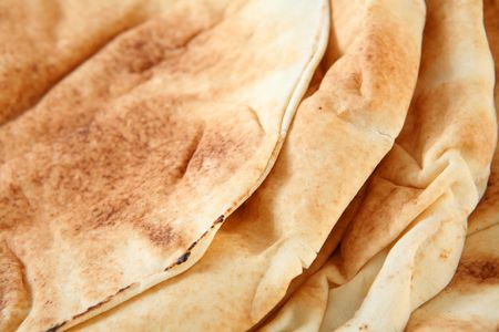 arabian food: Traditional, flat Arab bread or qubus, extreme close-up