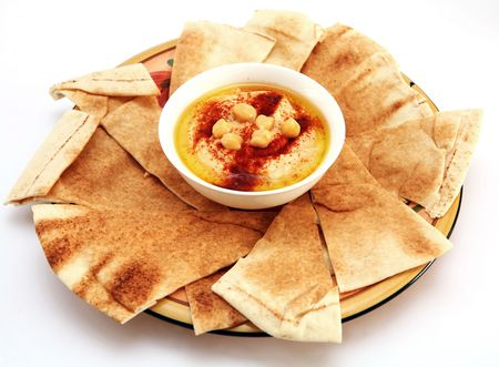 Hummus and traditional Arabian flat bread, or qubus. Stock Photo - 1050539