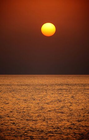 persian gulf: The sun rising out of the mist over the Arabian (or Persian) Gulf. Stock Photo