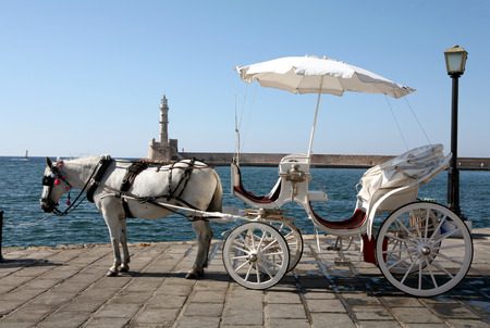A horse-drawn taxi on the harbour front at Hania, Crete, offering trips round the old town to tourists.