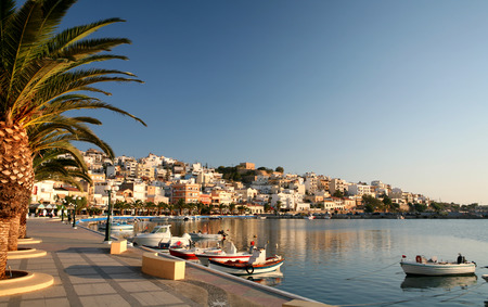 The seafront promenade at Sitia, the main town of Lasithi province, Crete, in early morning light.