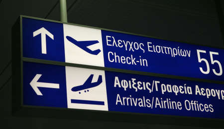 arrivals: A sign board for check-in desks and the arrivals lounge, in English and Greek, at Eleftherios Venezelos international Airport, Athens