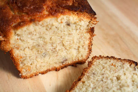 banana bread: A delicious loaf of fresh-baked banana bread on a wooden chopping board