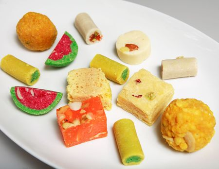 subcontinent: Traditional sweets from the Indian subcontinent, mostly created from sugar and coconut and other nuts. They are handed out to friends on all manner of festive occasions. Stock Photo
