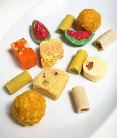 subcontinent: Indian (subcontinent) sweets laid out on a plate. Sweets are shared at all manner of celebrations within the Indian community.