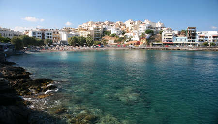 polarised: A beach in the Cretan resort town of Aghios Nikolaos, in the eastern half of the island.