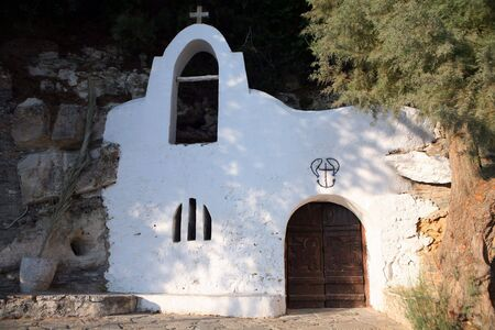 fishermens: The fishermens church, at the back of Lake Voulismeni in Aghios Nikolaos.  Stock Photo
