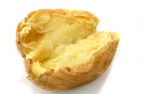baked potatoes: A baked potato with butter melted on it over a white background Stock Photo
