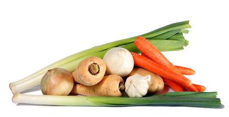 An assortment of winter vegetables against a white background. photo