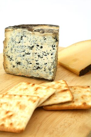 cheeseboard: A cheeseboard with blue Valdeon cheese from Spain and Dutch Gouda, together with cream cracker biscuits