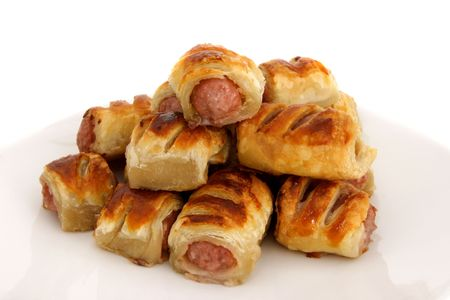 A pile of sausage rolls - sausages cooked in pastry - a traditional British treat often included as part of the  feast.