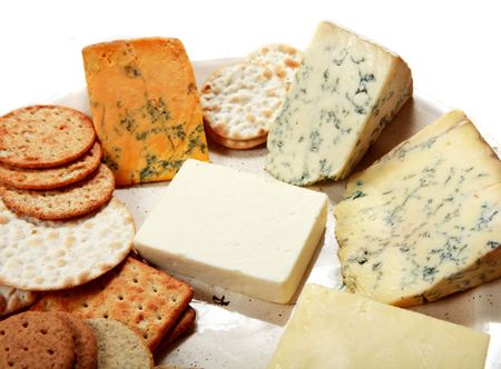 clockwise: A plate of fine English cheeses with an assortment of biscuits. Clockwise from top left: Shropshire Blue, Blue Stilton, Wensleydale blue, mature cheddar and white Cheshire.