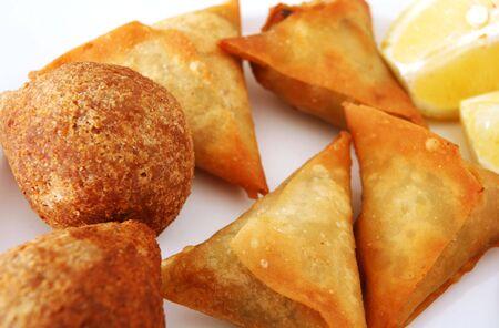samosa: A plate of Arabian kubbe (meatballs) and samosa pastries