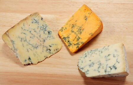 stilton: Three English blue cheeses on a board. From left, Wensleyday, Shropshire and Stilton.