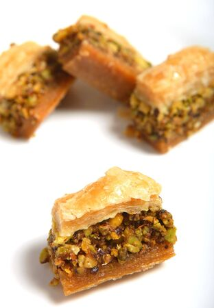 baklava: Traditional Arabian baklava pastries on a plate, extreme close-up.