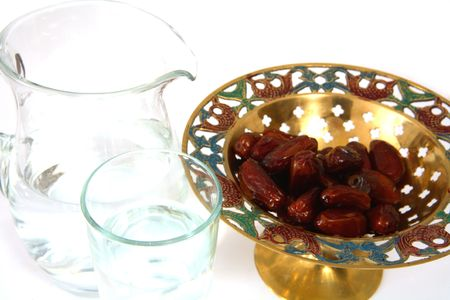 holy jug: A bowl of dates and a jug and glass of water - the things used to break the fast at sunset during the Muslim holy month of Ramadan