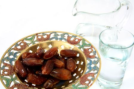 break fast: A bowl of dates and a jug and glass of water - the things used to break the fast at sunset during the Muslim holy month of Ramadan