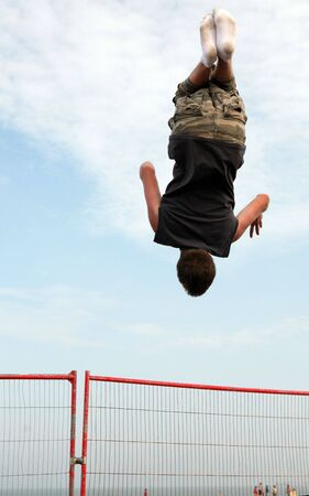 midair: A youth trampolining on the beach at Great Yarmouth, England