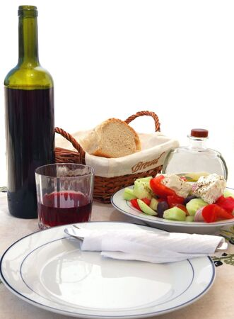 reported: A typical Mediterranean meal of fresh vegetables, olive oil, bread and wine. This kind of diet is has been reported as having all kinds of health benefits. Stock Photo