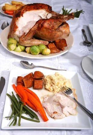 ovenbaked: A traditional thanksgiving dinner of turkey, candied carrots, green beans, oven-baked glazed sweet potato chunks and twice-cooked creamed mashed potato Stock Photo